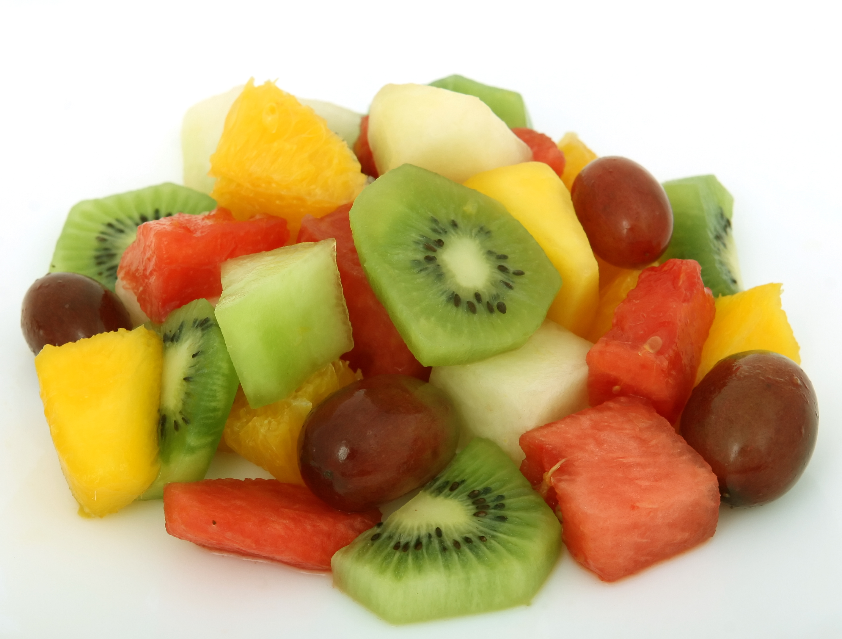 Fruit salad cocktail on a plate